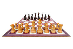 Boxwood chessboard with all pieces on white Royalty Free Stock Photography