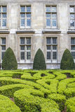 Boxwood in a park in front of a historic facade Royalty Free Stock Photography