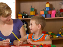 The boy. The mum with son is engaged in a children's room Royalty Free Stock Image