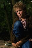 Boy. Portrait of a handsome boy (8) thoughtful looking in the camera. Picture is taken in a forest Stock Photos