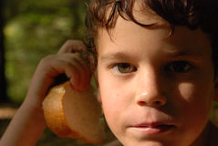 Boy. Portrait with boy with a piece of bread in his hand Stock Photos