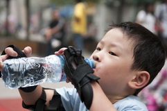 Boy. Sports gap, drink a little boy Royalty Free Stock Photography