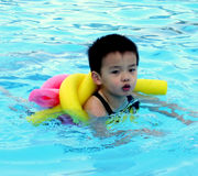 Boy. A boy is swimming in a pool Stock Photo