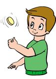 Boy. Tosses a coin for good luck Royalty Free Stock Photography