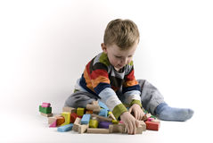 The boy. The child the boy plays cubes on a white background Stock Photography