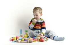 The boy. The child the boy plays cubes on a white background Stock Image