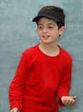 Boy. A boy in red on a green background Royalty Free Stock Photo