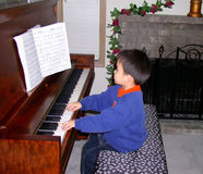 Boy. A boy is playing a piano Royalty Free Stock Photos