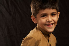 Boy. Young south asian looking at camera royalty free stock photography