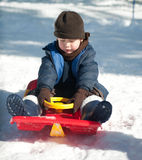 Boy. The boy sits on a sled Royalty Free Stock Images