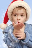 The boy. Blows on white snowflakes on a hand Royalty Free Stock Images