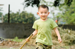Boy. Wearing a green clothes Chinese children Royalty Free Stock Image