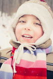 Boy. Dressed in cap and scarf at cold winter day Stock Photos
