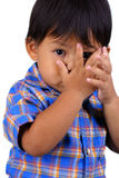 The boy. Photograph of boy iclosing face with his hand stock images