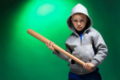 Boy. A little blond boy on green background Royalty Free Stock Photography