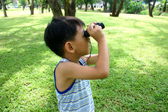 Boy. With bonoculars royalty free stock photography
