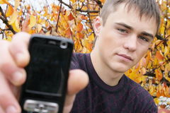 Boy. The boy with a mobile phone royalty free stock image
