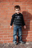 Boy. On a background a brick wall Stock Image