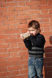 Boy. On a background a brick wall Stock Photo