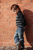 Boy. On a background a brick wall Royalty Free Stock Images