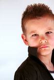 Boy. Is looking straight into the camera Royalty Free Stock Images