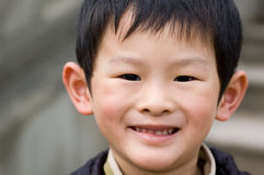 Boy. Young boy's simple-hearted smiling face Stock Images