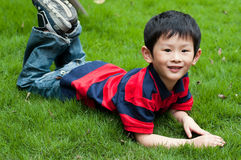 Boy. The weather is good, the young boy enters the nature, breathes the fresh air Stock Photography