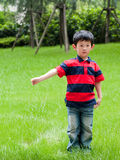 Boy. The weather is good, the young boy enters the nature, breathes the fresh air Royalty Free Stock Image