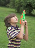 Boy. With water gun Stock Image