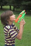 Boy. With water gun Royalty Free Stock Photography