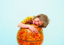 Boy. Teen Hugging Old Fashioned Globe Against Light Green Background Stock Images