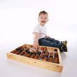 Boy with abacus isolated on white Royalty Free Stock Photo