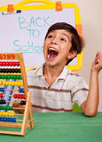 Boy with abacus screaming loudly Royalty Free Stock Photography