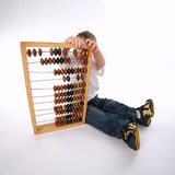 Boy with abacus  on white Royalty Free Stock Photography
