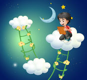 A boy above the cloud watching a picture Stock Image