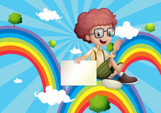 A boy above the rainbow holding an empty board Royalty Free Stock Photos