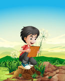 A boy above a stump holding a picture frame Royalty Free Stock Photo