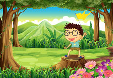A boy above the stump holding a yellow banner Stock Photo