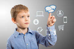 Boy accessing futuristic entertainment applications. From the cloud computing interface Royalty Free Stock Images