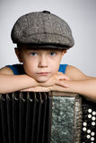 Boy with accordion. Stock Images