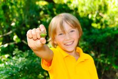 Boy and acorn. Boy hold acorn in the park Stock Images