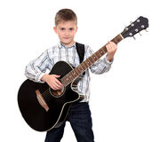 The boy with an acoustic guitar Royalty Free Stock Photography