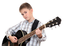 The boy with an acoustic guitar Stock Photo