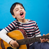 Boy with acoustic guitar Royalty Free Stock Photos