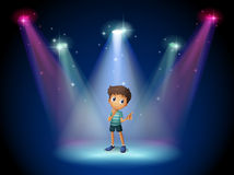 A boy acting at the stage with spotlights Stock Photography