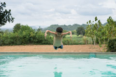 Boy in action on the pool Royalty Free Stock Photos