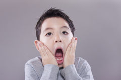 Boy acts surprised. Royalty Free Stock Image
