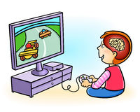 Boy addicted to playing video games. Excessive video game playing in kids may harm the brain Stock Photo