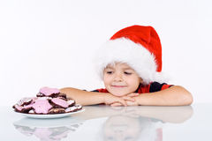 Boy admiring the christmas gingerbread cookies Royalty Free Stock Photography