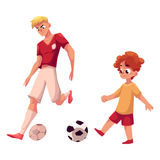 Boy and adult soccer player playing football, choice of profession Royalty Free Stock Image